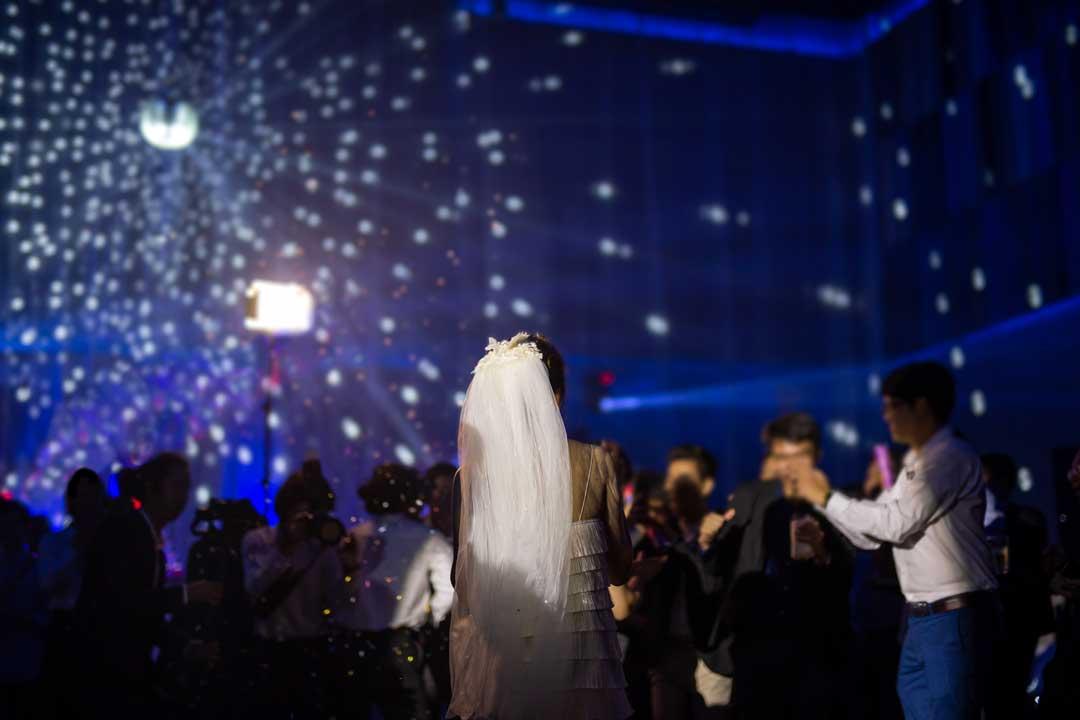 wedding party guests dark dance floor disco ball